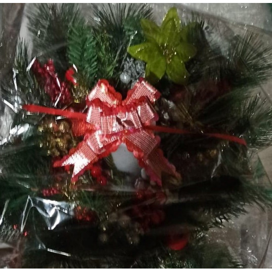 Christmas arrangement with basket light wicker square tray.