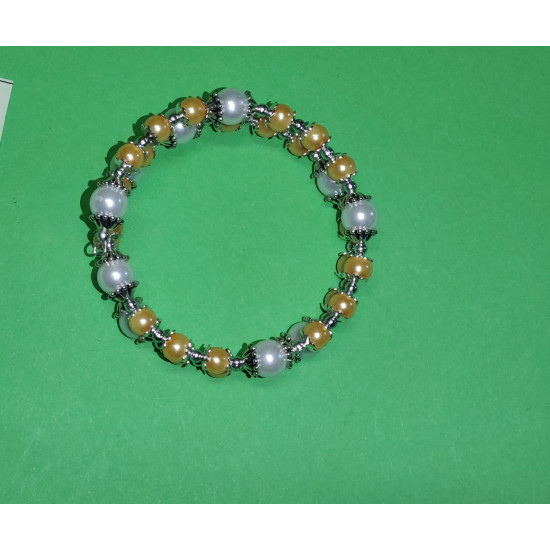 Yellow acrylic pearl bracelet, toho beads, white acrylic pearls silver beads and Tibetan silver caps.