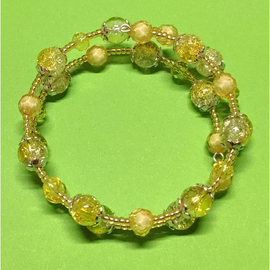 Toho bead bracelet, yellow faceted crystals, acrylic faceted pearls, yellow-white crackle glass beads.