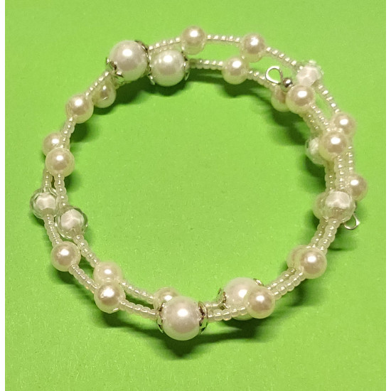 White glass beads, white acrylic beads, toho beads and silver caps.