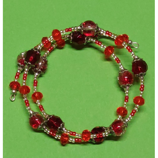 Toho beads, red and burgundy faceted glass crystals, crackle glass beads, silver caps.