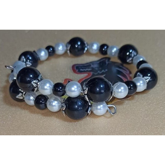 Different colours glass beads. The bracelet is handmade on memory wire, universal size.