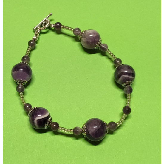 Bracelet about 18-20 cm of amethyst beads and spherical amethyst, toho beads, Tibetan silver Toggle clasp. Handmade on silicone wire.