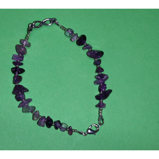 Bracelet about 21 cm of amethyst chips with lobster clasps. The bracelets are made by hand on silicone wire.