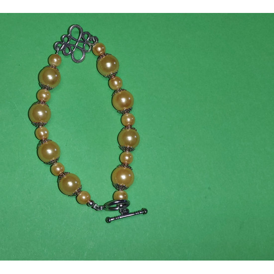 Bracelet about 21 cm made of yellow glass beads