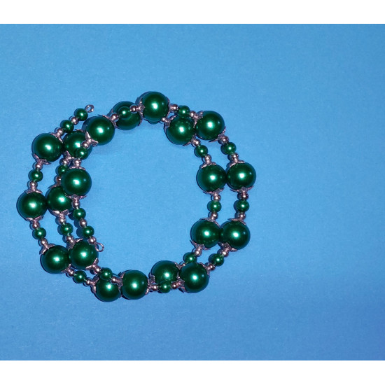 Bracelet 2 turns. Green glass beads, and Tibetan silver caps. The bracelet is handmade on memory wire.