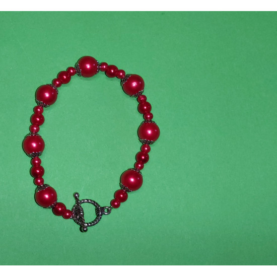 Red glass beads and Tibetan silver caps