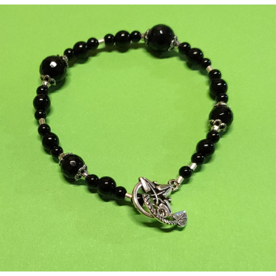 Bracelet about 21 cm. Obsidian beads, onyx and silver spacers