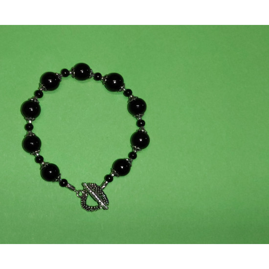 Bracelet about 21 cm black glass beads, Tibetan silver caps