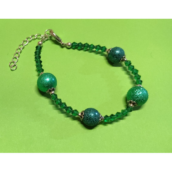 Bracelet about 21 cm made of glass pearls, stardust, pastel green and emerald green, green biconical faceted glass crystals