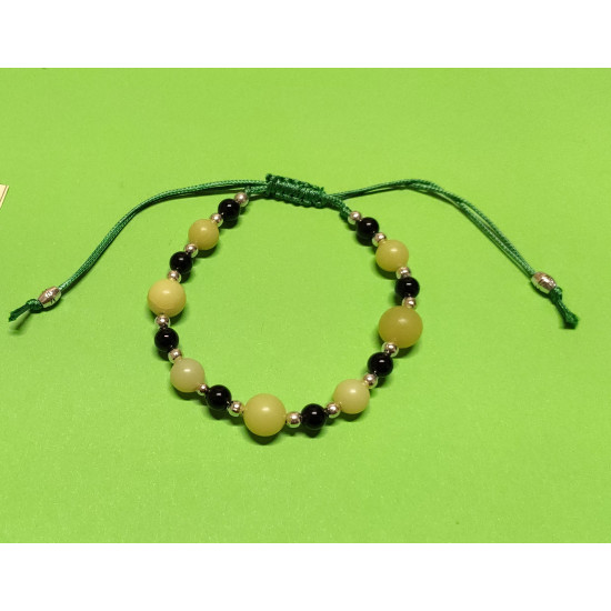 Bracelet length 15 cm-22 cm onyx beads, lemon jade and silver balls The bracelet is handmade on green waxed cord with adjustable cord clasp.