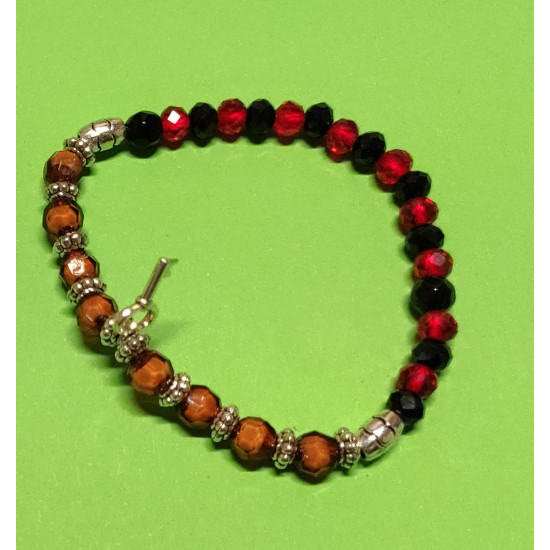 Transparent red, black glass biconical crystal bracelet and Tibetan silver spacers with Tibetan silver key charm. The bracelet is made by hand on an elastic drop.