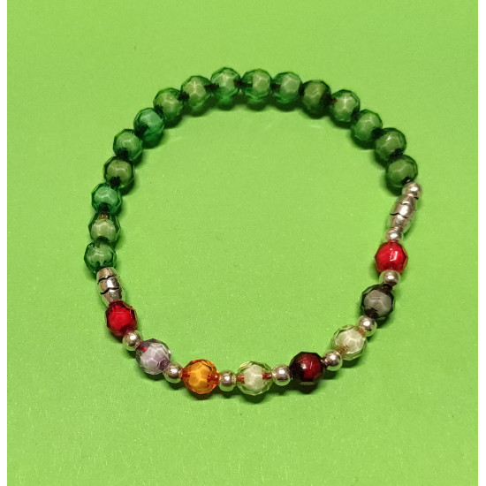 Bracelet made of acrylic beads of different colors, Tibetan silver spacers and silver balls. The bracelet is made by hand on an elastic drop.