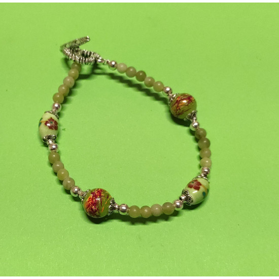 Bracelet about 21 cm. Taiwanese olive green jade beads, light green oval porcelain beads, & Glossy & glass beads, silver balls and Tibetan silver caps.