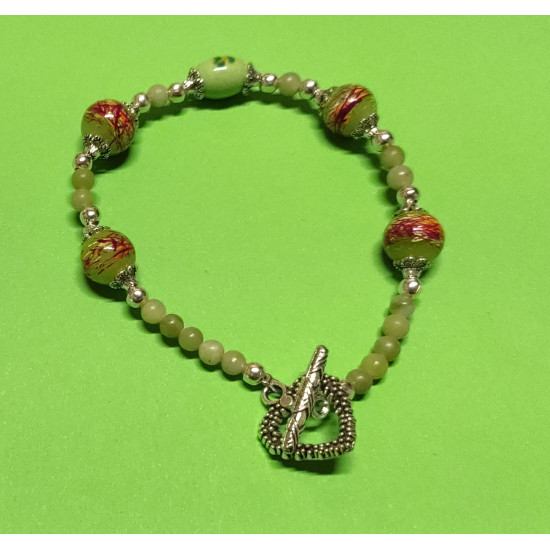 Bracelet about 21 cm. Taiwanese olive green jade beads, light green oval porcelain beads, &Glossy & glass beads, silver balls and Tibetan silver caps