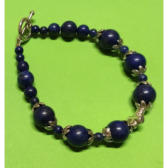 Bracelet about 20 cm. Lapis lazuli beads, Tibetan silver caps and cross spacers. The bracelet is handmade on silicone wire with silver toggle clasps.