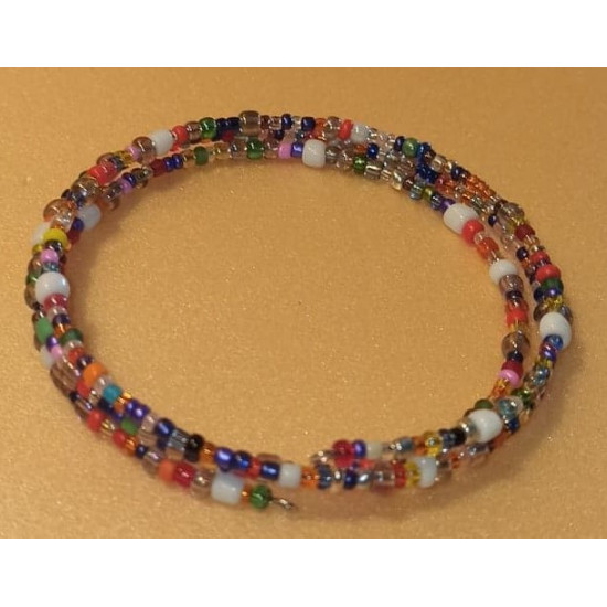 Memory wire bracelet with different colors and sizes of sand beads. Handmade on wire with 3 turns memory.