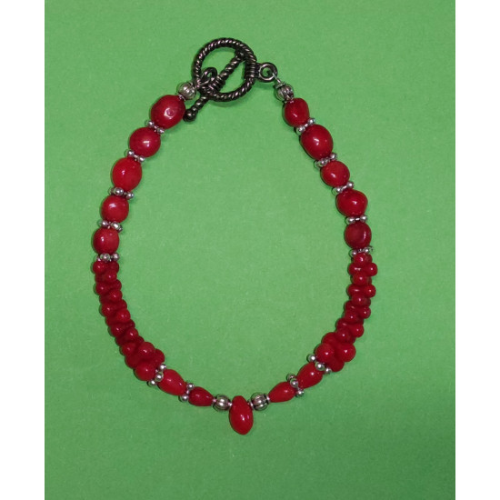 Bracelet about 19 cm. Coral red beads, hourglass Coral red beads and Tibetan spacer