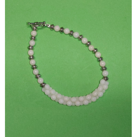 Bracelet about 19-20 cm. Coral cream beads, hourglass, Coral cream beads and Tibetan spacer