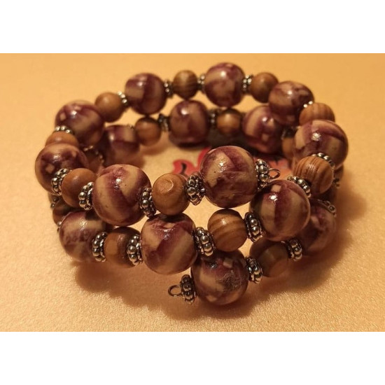 Wooden bead bracelet with brown dashes, Tibetan spacer with beads. The bracelet is handmade on memory wire.