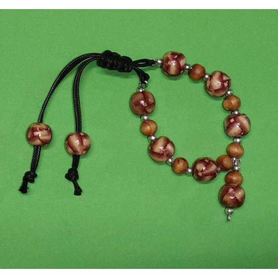Bracelet. Wooden beads with brown dashes, silver ball spacer. The bracelet is made by hand on silicone wire with black cord clasps with small brown balls.