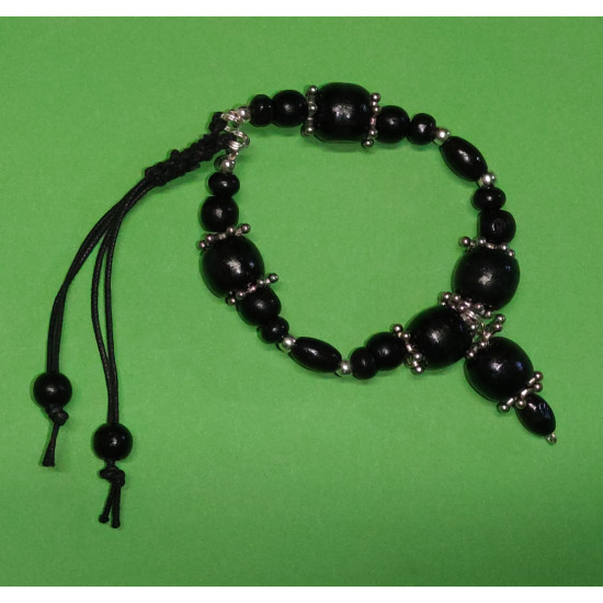 Bracelet. Black wood beads, silver snowflake spacer and silver ball