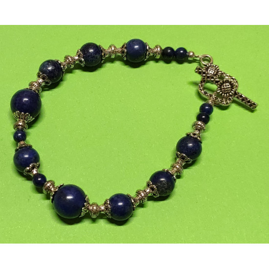 Bracelet about 21 cm. Lapis lazuli beads, spacer and Tibetan silver cap, flower.