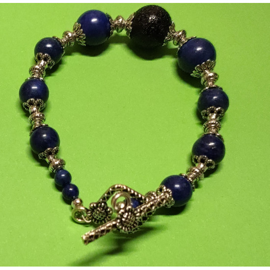 Bracelet about 20.5 cm. Lapis lazuli beads, spacer and Tibetan silver cap, flower. Handmade bracelet on silicone wire with silver toggle clasps.
