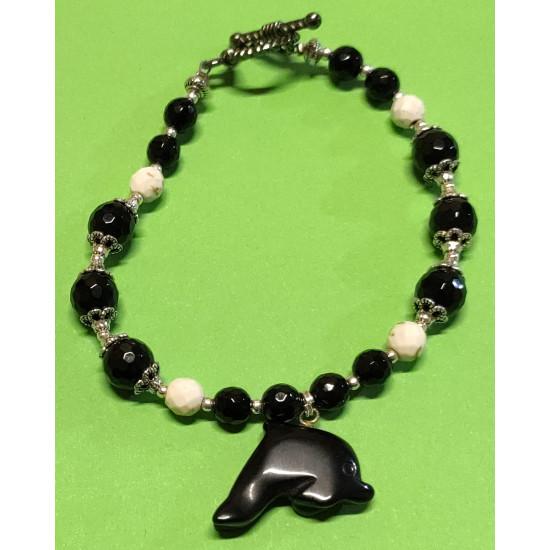 Handmade bracelet on silicone wire black onyx stones and magnesite