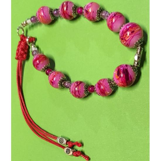 Bracelet about 21 cm pink glass beads.