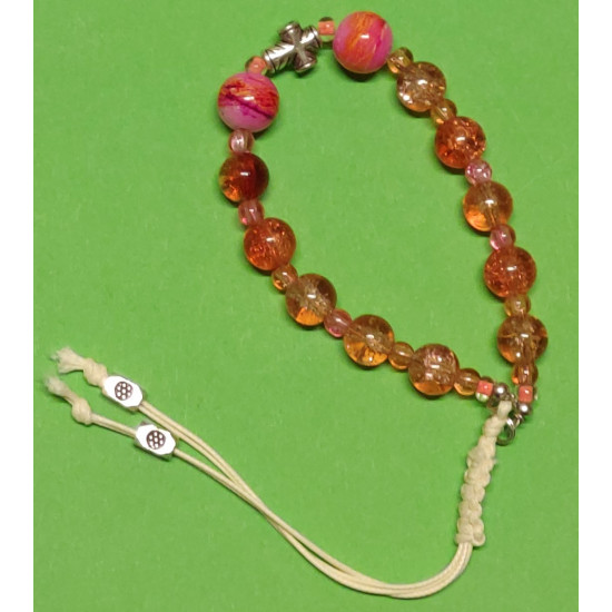 Bracelet about 19 cm. Orange to pink glass beads. Crackle glass beads and orange-white pink