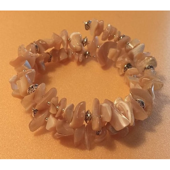 Beaded mother of pearl chips bracelet, Tibetan silver spacer and silver plated crimps. The bracelets are made by hand on memory wire, 2 turns.