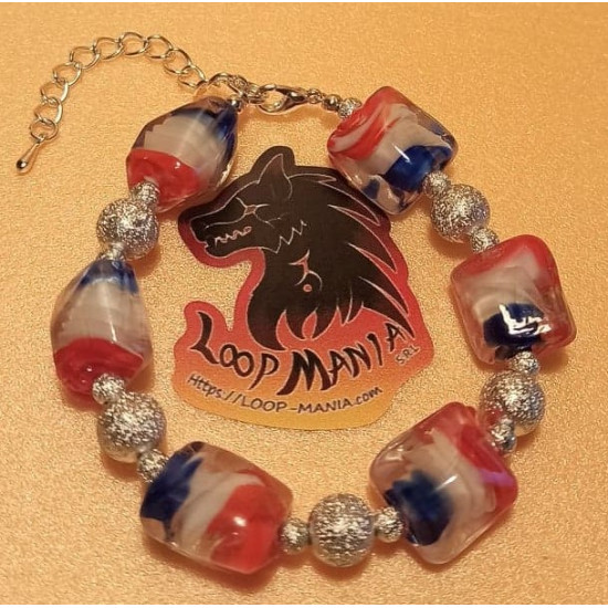 Bracelet with lampwork glass beads with blue-white-red spiral inside16x15x14mm, made of silicone wire, silver stardust beads and silver accessories. Length 17-18 cm + 5 cm silver extension, lobster lock.