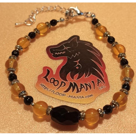 Natural amber bracelet and onyx beads, length about 19 cm + 5 cm extension plated with silver. Made of silicone wire, natural amber and onyx beads, gold spacer with crystals, silver-plated spacer and silver lobster clasps.