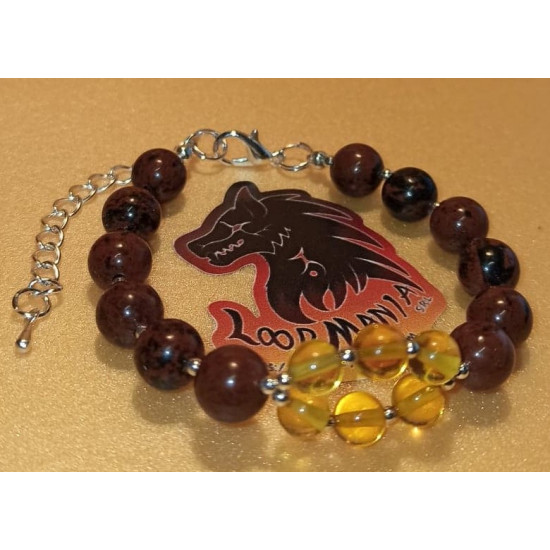 Natural amber bracelet and obsidian beads, length about 18 cm + 5 cm silver-plated extension. Made of silicone wire, natural amber, obsidian spheres, spacer, silver-plated spacer and silver lobster clasps.