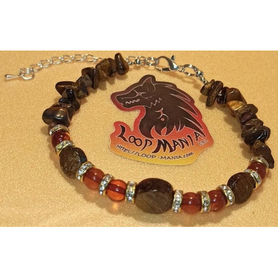 Natural amber bracelet and tiger's eye beads, length about 18 cm + 5 cm silver-plated extension. Made of silicone wire, natural amber, tiger eye spheres and pennies, gold spacer with crystals, silver-plated spacer and silver lobster clasps.
