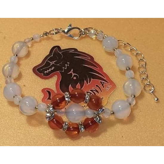 Natural amber bracelet with opalescent beads, length about 18 cm + 5 cm silver-plated extension. Made of silicone wire, natural amber, opalescent spheres, gold spacer with crystals, silver-plated spacer and silver lobster clasps.