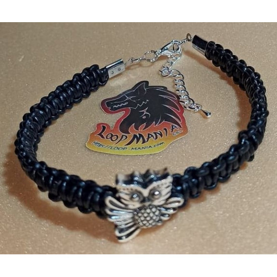 Leather braided bracelet with metal beads. Woven from natural leather 3 threads of 2 mm with Tibetan silver owl bead. Size 24.8 and 23 cm plus silver plated extension 5 cm with silver plated lobster locks.