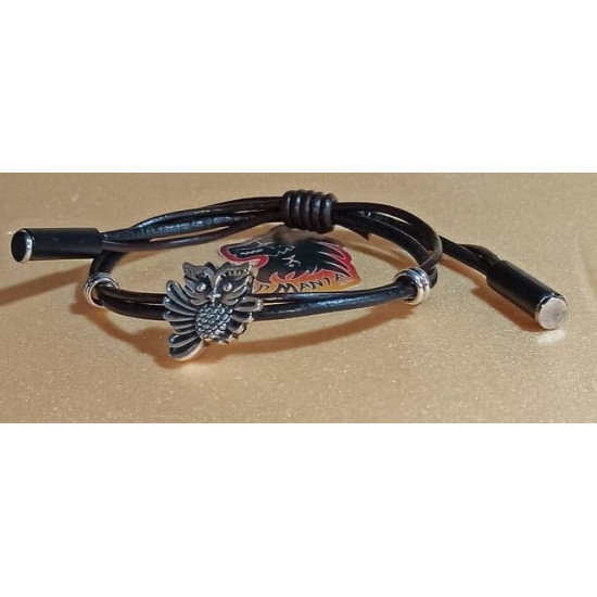 Leather bracelet with silver spacer. Made of natural leather 2 threads 2 and 3 mm with metal beads made of Tibetan silver. Universal size with sliding leather knot.