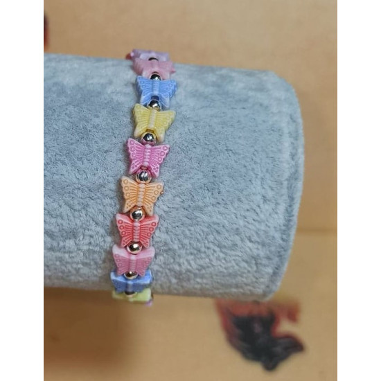 Plastic beaded bracelet with elastic for girls. Made of plastic beads. Universal size starting from 13 cm.