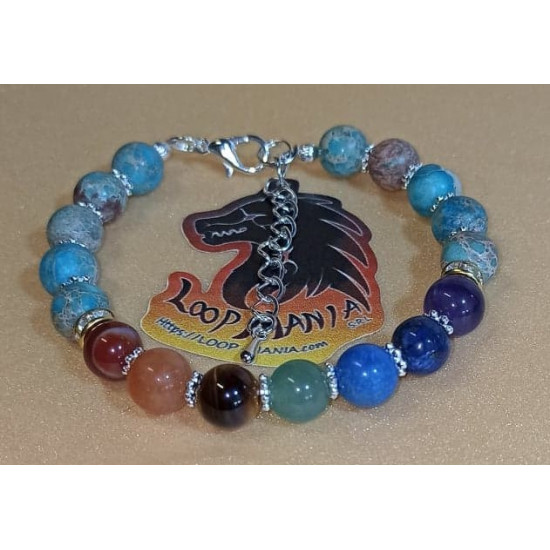 7 chakra bracelet with silver plated accessories. Elastic bracelet or silicone wire with silver-plated lobster clasp, made of different semiprecious beads 8 or 6 mm and 7 chakras: carnelian, orange jade, tiger's eyes, green aventurine, blue imperial jaspe