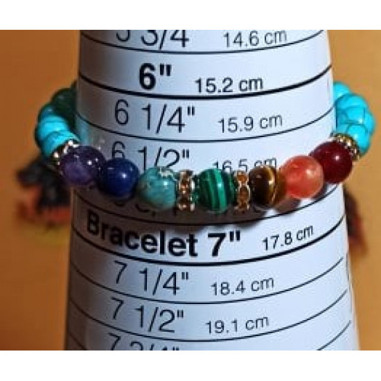7 chakra bracelet with silver plated accessories. Elastic bracelet or silicone wire with silver-plated lobster clasp, made of different semiprecious beads 8 or 6 mm jasper. agate, howlite and 7 chakras: dark red jade, orange jade, tiger eyes, green synthe