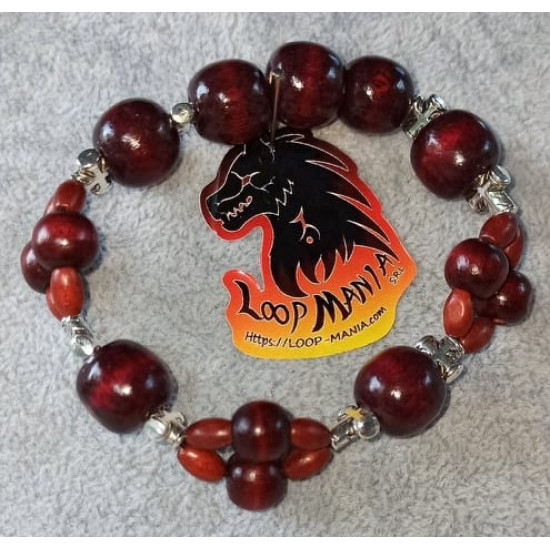Bracelet with wooden beads different shapes and colors. Made of elastic with silver spacers or with spacers with different colored rhinestones.     BRT321-1 = 18.4 cm   BRT321-2 = 16.5 cm   BRT321-3 = 15.9 cm     BRT321-4 = 17.8 cm   BRT321-5 = 17.1 cm