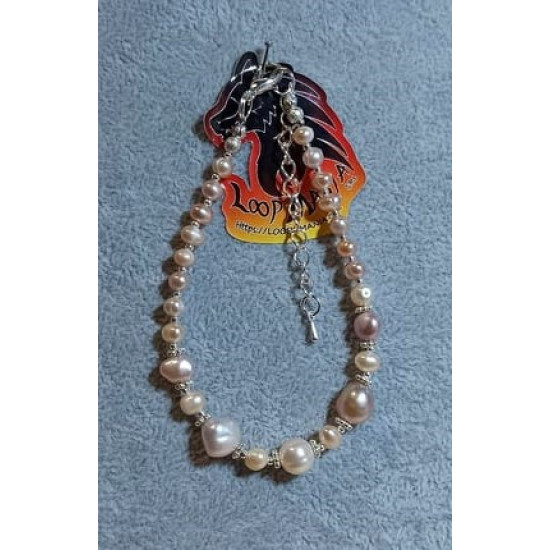 Natural (cultured) pearl bracelet with spacers and silver plated beads. Made of silicone wire with silver-plated lobster clasps and silver extension.   BRT324-1 = 20.3 cm + 5cm,   BRT324-2 = 19.1 cm + 5 cm,   BRT324-3 = 19.1 cm + 4 cm,   BRT324-4 = 19.1 c