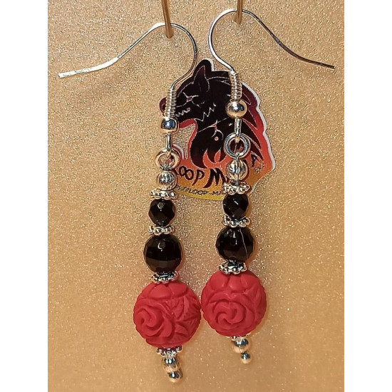 Earrings cinnabar and onyx spheres. Made of silver-plated needles and cakes, faceted onyx spheres, cinnabar spheres and silver-plated spacer spacers.