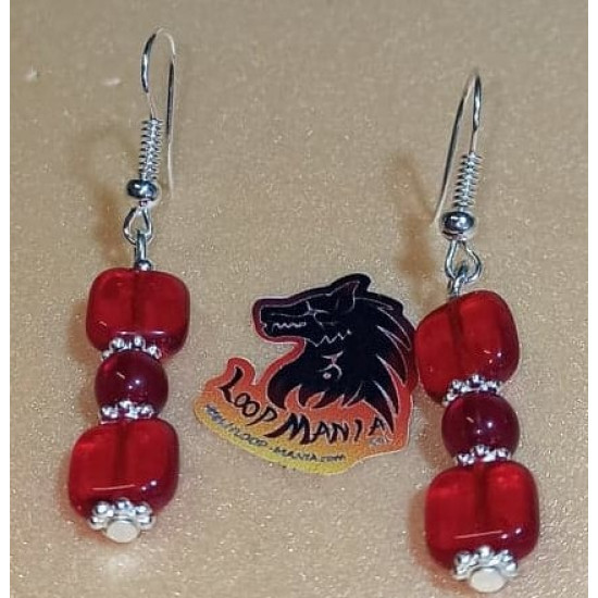 Earrings.  Glass bead earrings with spacers and silver plated cakes.