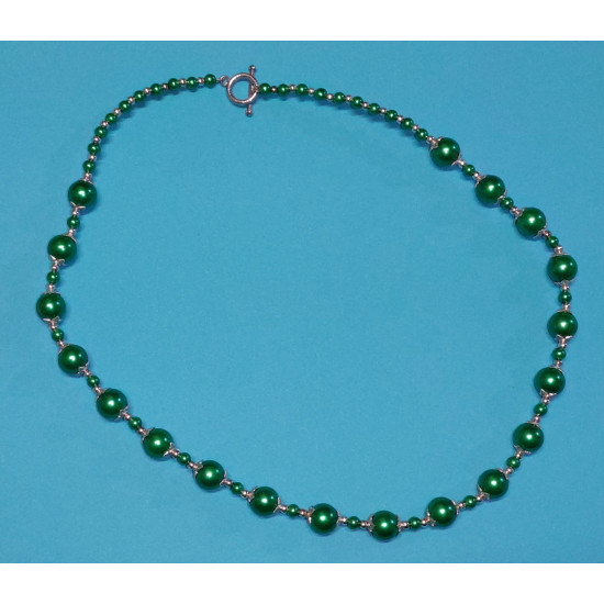 Necklace about 50 cm. Green glass beads and Tibetan silver caps.
