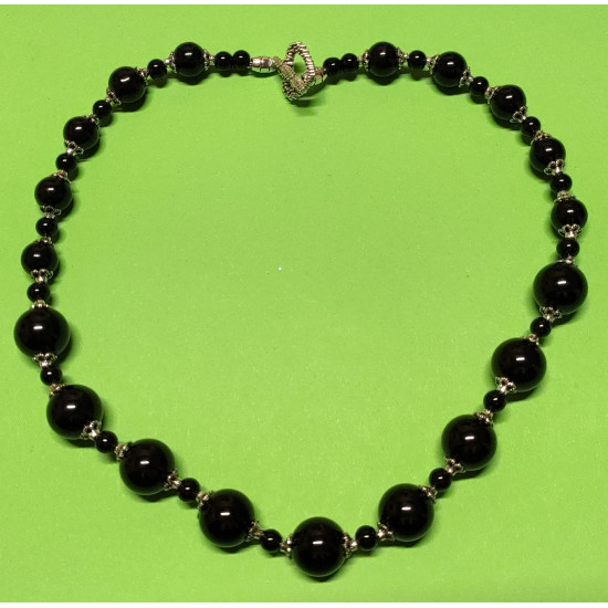 Black glass beads, Tibetan silver caps, Tibetan silver spacers.