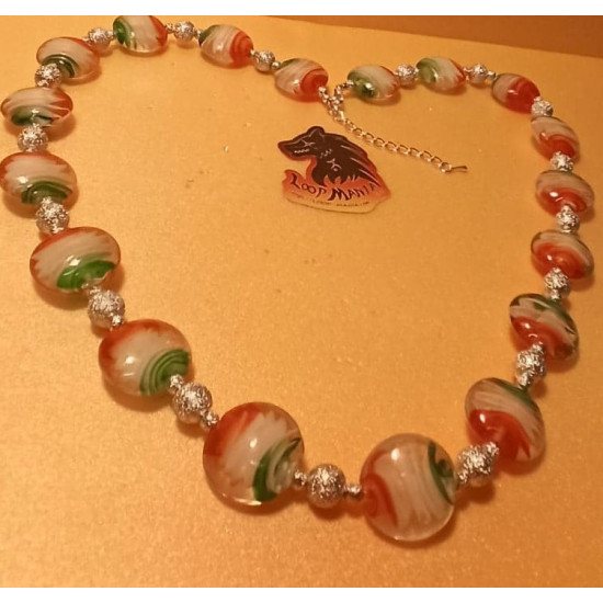 Necklace with lampwork glass beads with blue-white-red spiral half 20x10mm, green-white-red 20x10mm, made of silicone wire, silver stardust beads and silver accessories. Length 53-57 cm + 5 cm silver extension, lobster lock.