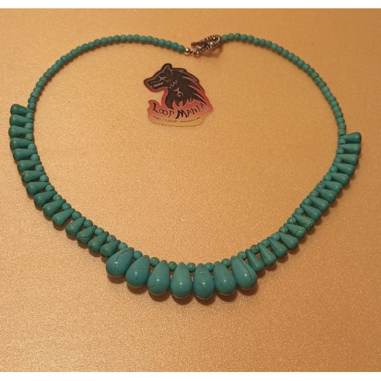 Necklace about 49 cm. Synthetic turquoise beads, tear briquettes, tear turquoise beads and silver balls. The necklace is handmade on silicone wire with Tibetan silver toggle clasps.